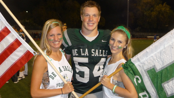 Junior lineman Sumner Houston from De La Salle of Concord gets greeted by flag girls after one of the team's 15 wins during the 2012 season. Houston, younger brother of 2009, 2010 and 2011 starting quarterback Bart Houston, should be one of the team's top players next season.