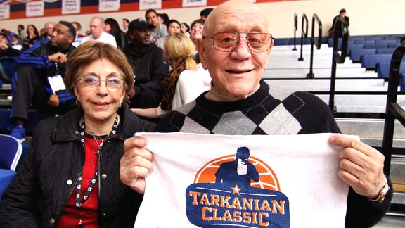 College basketball coaching icon Jerry Tarkanian shows off a commemorative towel with a logo that shows him biting one as he did every game on the bench. Tarkanian witnessed Mater Dei's victories over Bishop Gorman (La Vegas) and Morgan Park (Chicago). Photo by Nick Koza