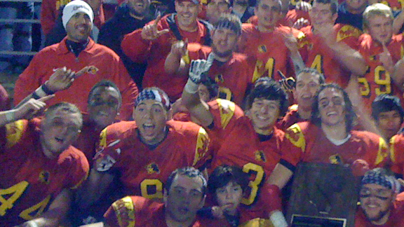 Oakdale head coach Trent Merzon (upper left in white beanie) and his players at Oakdale show their emotion after 27-24 win over Clayton Valley last Saturday night in Stockton for CIF NorCal D2 regional crown. Photo by Paul Muyskens.