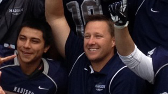 Coach Rick Jackson of San Diego Madison poses with team after CIF Division III bowl victory.