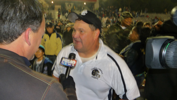 Central Catholic of Modesto head coach Roger Canepa talks to the media after his team's win over McClymonds of Oakland in the CIF Division IV Northern California regional bowl game.