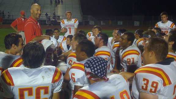Oakdale coach Trent Merzon talks to his team after one of its 13 victories this season. Mustangs won CIF Sac-Joaquin Section D3 title on Friday night over Vista del Lago.