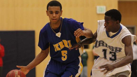 San Mateo Serra point guard Andre Miller dribbles up the court from a game last season. Photo: Willie Eashman.