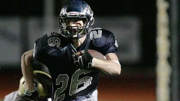 Jake Taylor from Rim of the World (Lake Arrowhead) broke a lot of tackles en route to piling up 4,036 yards and scoring 57 touchdowns. He became just the second player in state history with more than 4,000 yards, including five straight outings of 300 or more. He was considered runner-up to Marin Catholic's Jared Goff for small schools state player of the year. Photo by Tina Lingenfelter.