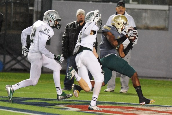 """First team all-state multi-purpose player John """"JuJu"""" Smith grabs a touchdown pass for Long Beach Poly in team's loss to Granite Bay in CIF Division I state bowl game. Photo by Scott Kurtz."""