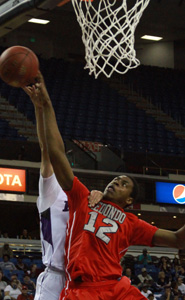 Jeremiah Headley of Redondo gets all ball on key blocked shot in the fourth quarter of team's D2 boys title game win over College Park. Photo: Willie Eashman.