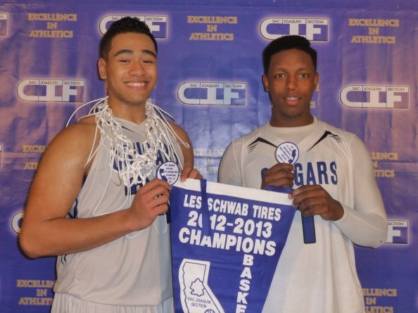 Nifae Lealao and Trey Belton (both grid-hoopers) show off some of the championship gear they and their team at Capital Christian of Sacramento collected after the CIF Sac-Joaquin Section Division V championship.