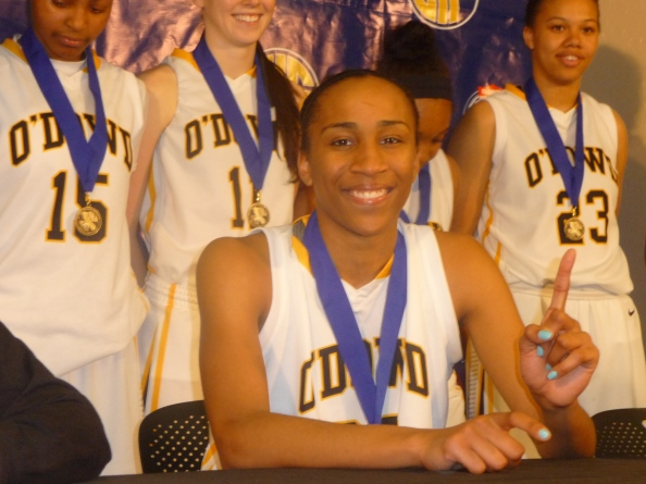 Duke-bound Oderah Chidom signals where she hopes her Bishop O'Dowd girls team will be ranked in the state when the final overall rankings are released next week after Saturday's Open Division state final.