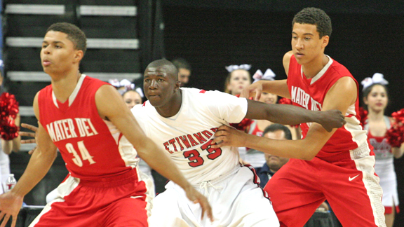 Mater Dei of Santa Ana players attempt to keep Etiwanda's Tim Myles from getting good position during the CIF Southern California Open Division regional final won by the Monarchs. Photo by Andrew Drennen.
