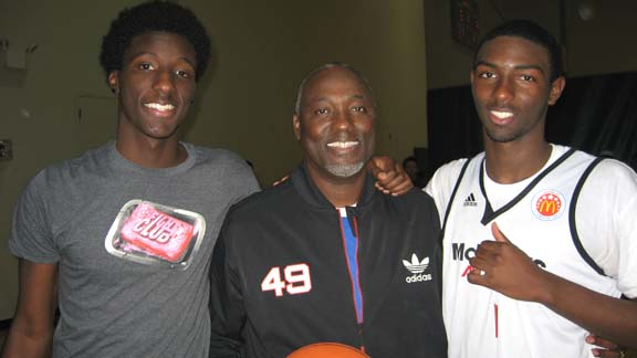 Daniel (left)  and father Gregory (middle) enjoy a moment with Isaac Hamilton following the first practice at the 2013 McDonald's All-American Game in Chicago. Photo: Ronnie Flores