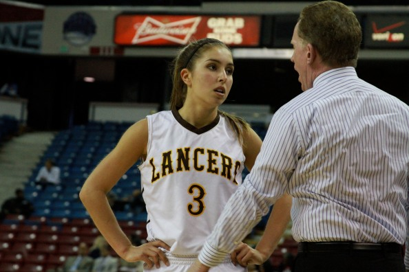 Senior guard Shelbi Aimonetti from St. Francis of Mountain View speaks with head coach Brian Harrigan during CIF Division II state championship against Lynwood. Photo: Willie Eashman.